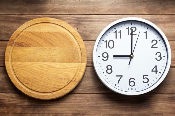 wall clock and pizza cutting board